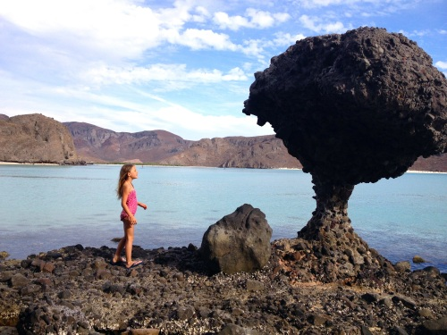 Our daughter marveling at the famous rock at Playa de Balandra outside La Paz.