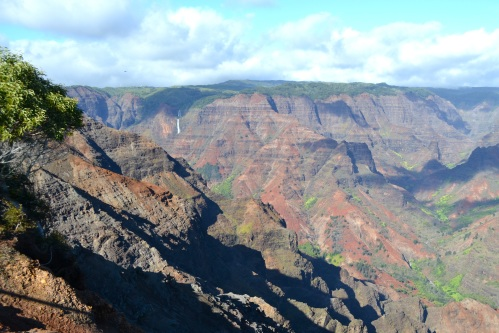 Waimea Canyon with a waterfall on the left.